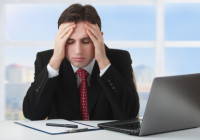young businessman under stress, fatigue and headache